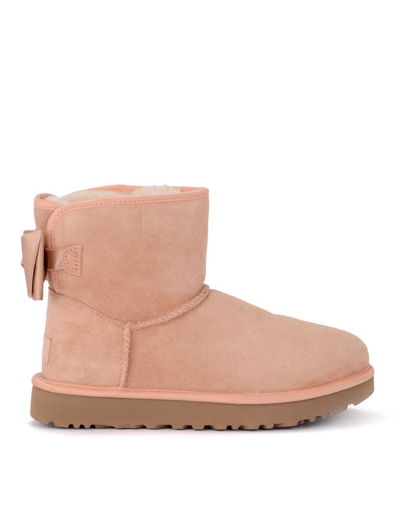 UGG Mini Bailey Bow Pink Sheepskin Ankle Boots With Satin Bow. - Pink
