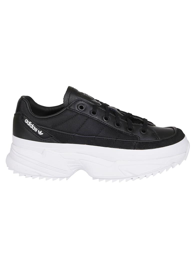 Adidas Originals Lcxon Sneakers in nero bianco