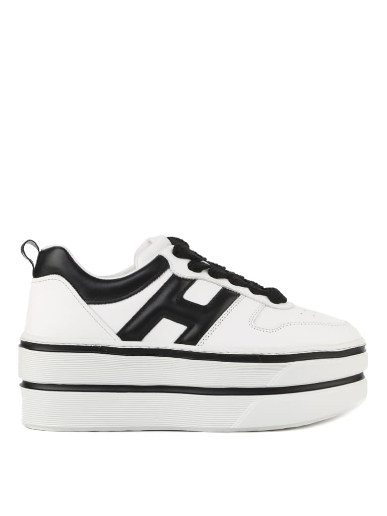 Best price on the market at italist | Hogan Hogan H449 Sneakers In White And Black Leather