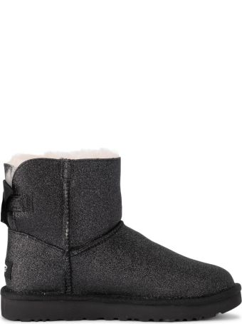 UGG Mini Bailey Bow Black Sheepskin And Glitter Ankle Boots.