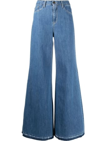 Merci Flared Jeans In Blue Denim