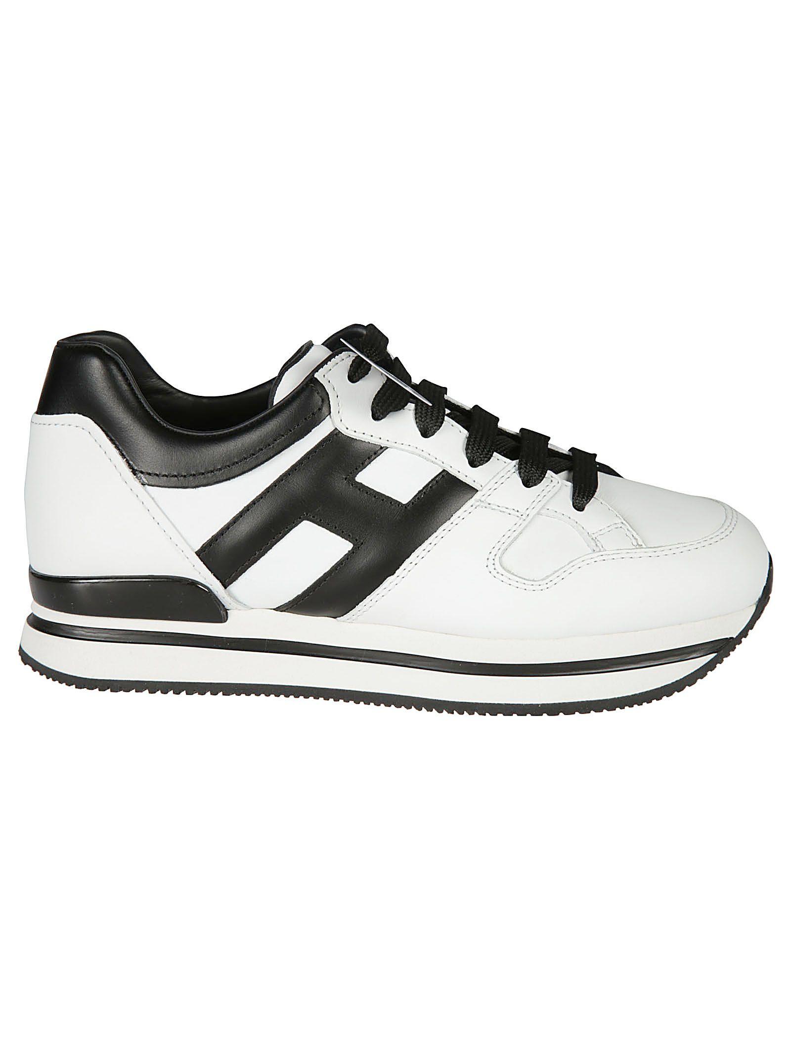 Shop Hogan H222 Sneakers In Bianco/Nero