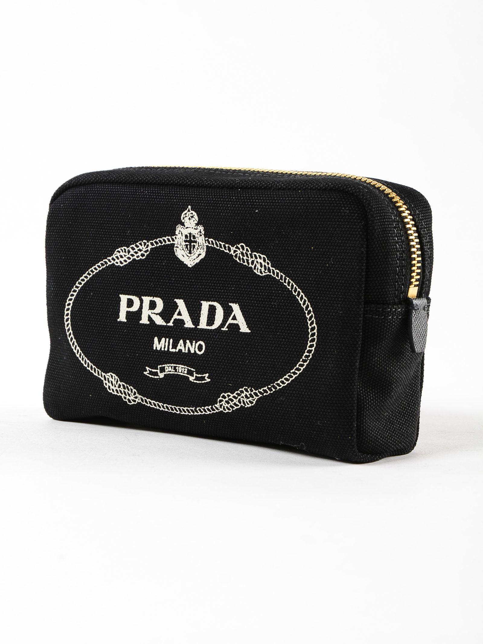 3af81cab4171 Prada Prada Canapa Logo Clutch - Nero+talco - 10779691   italist