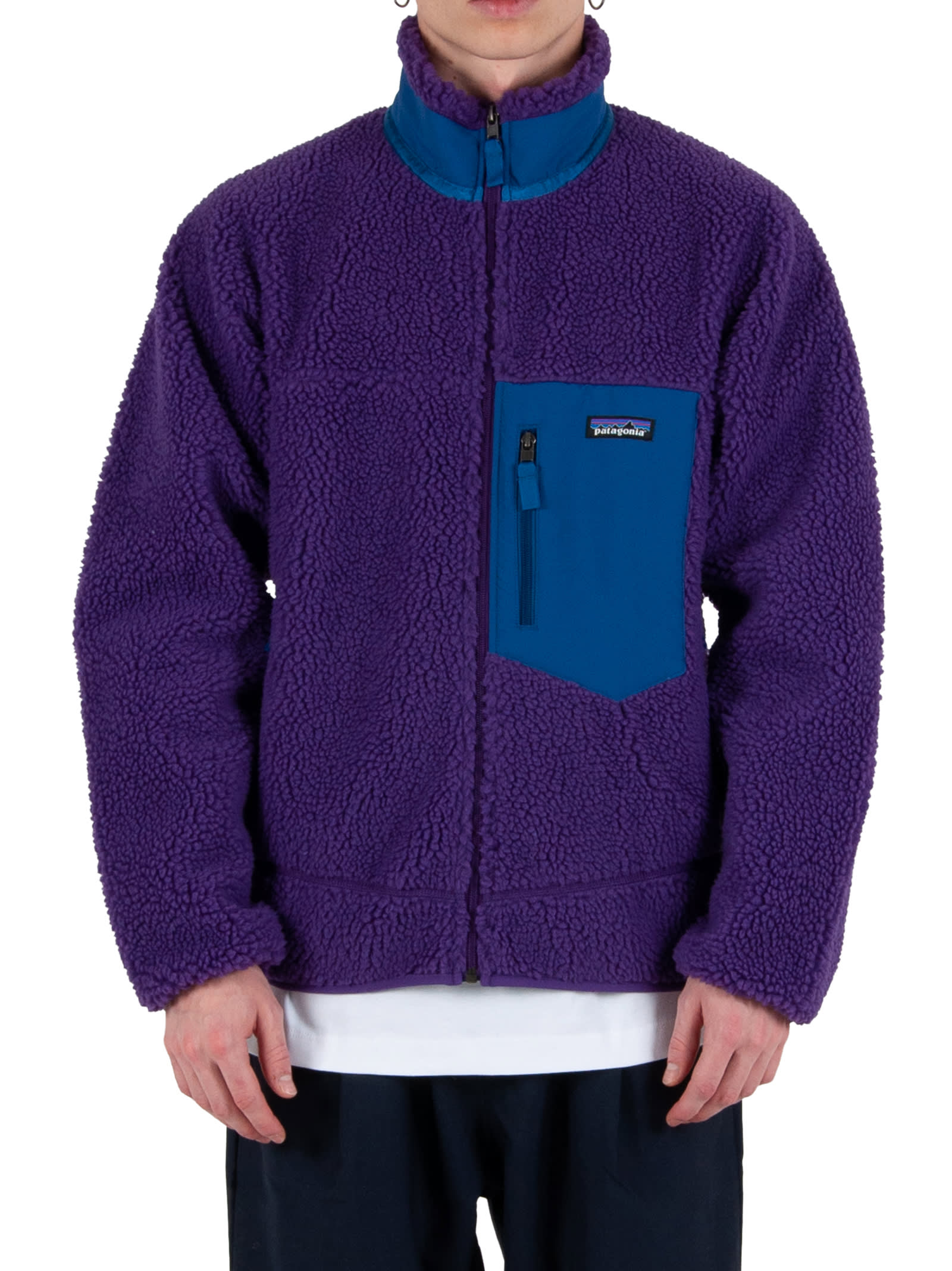 Zipper closure; - Chest Pocket with zipper closure; - Side pockets with zipper closure; - Logoed insert applied to chest. - Composition: 100% Polyester (50% Recycled) - Color: Purple