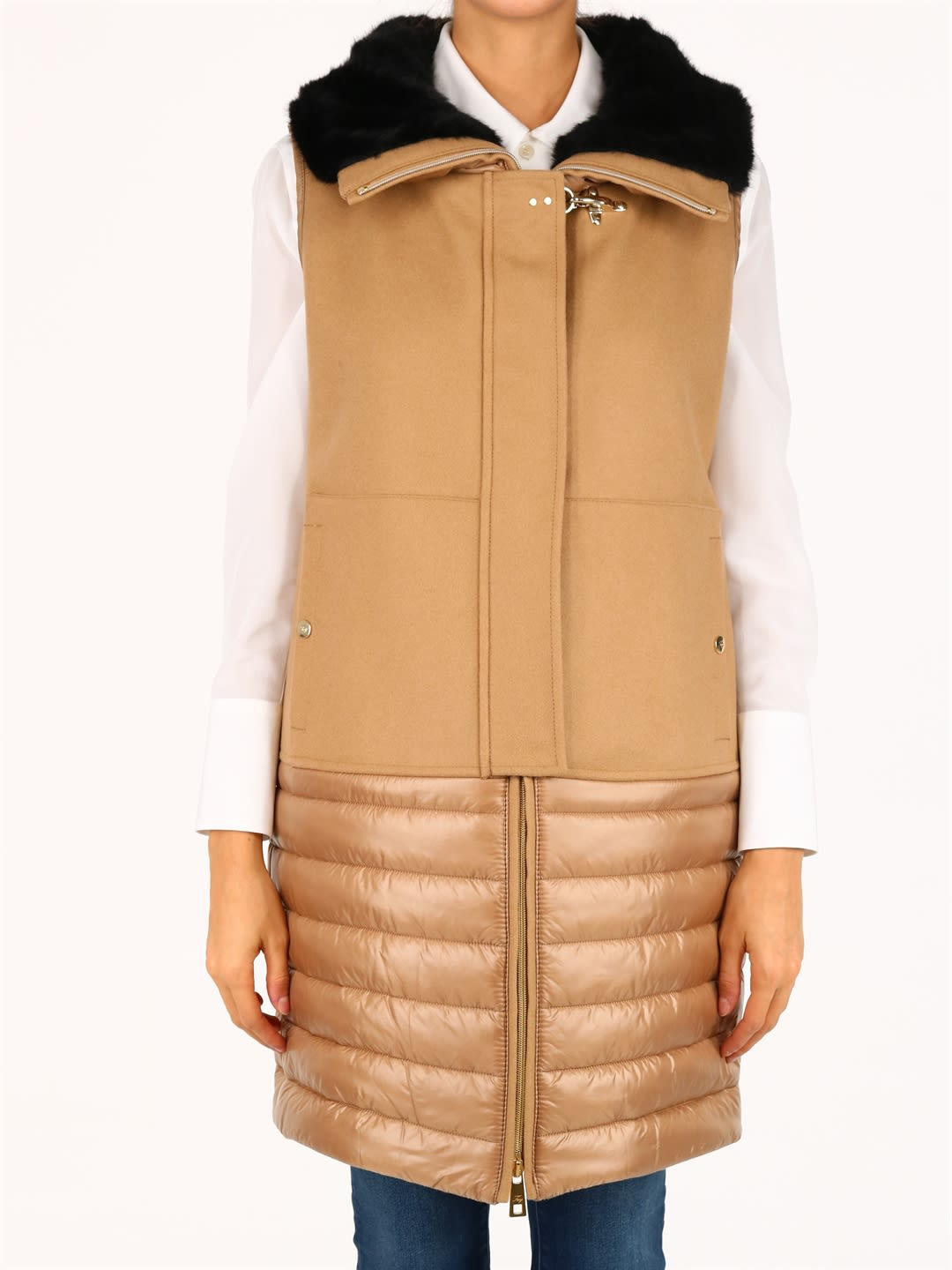 Vest with top in cloth and bottom in quilted nylon. Featuring a wraparound high collar with faux fur insert, it has a zip closure and hidden snaps, perfected by the iconic Fay hook. The model is 1. 70 cm tall and wears size SComposition: 50% Polyamide, 50% Virgin Wool