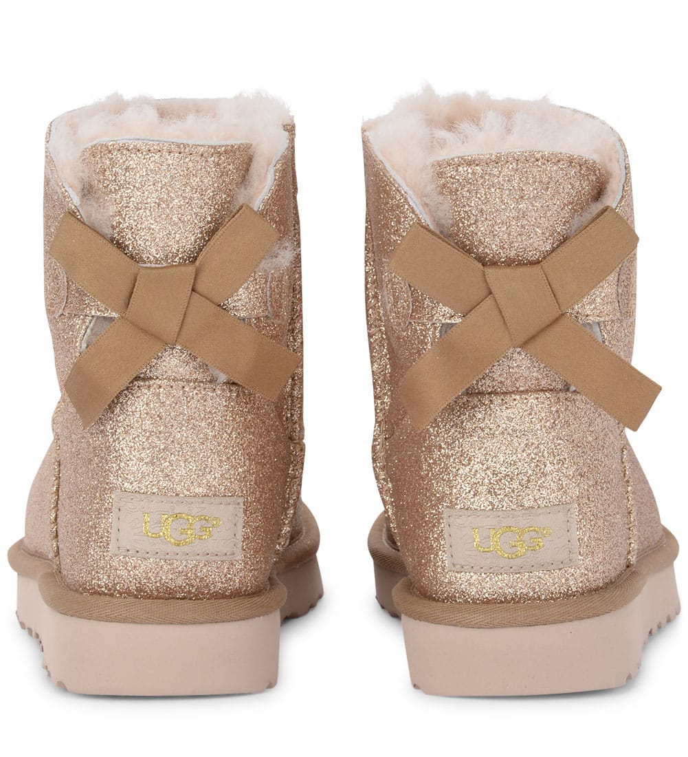 d506fe168 ... UGG Mini Bailey Bow Sheepskin And Golden Glitter Ankle Boots - ORO
