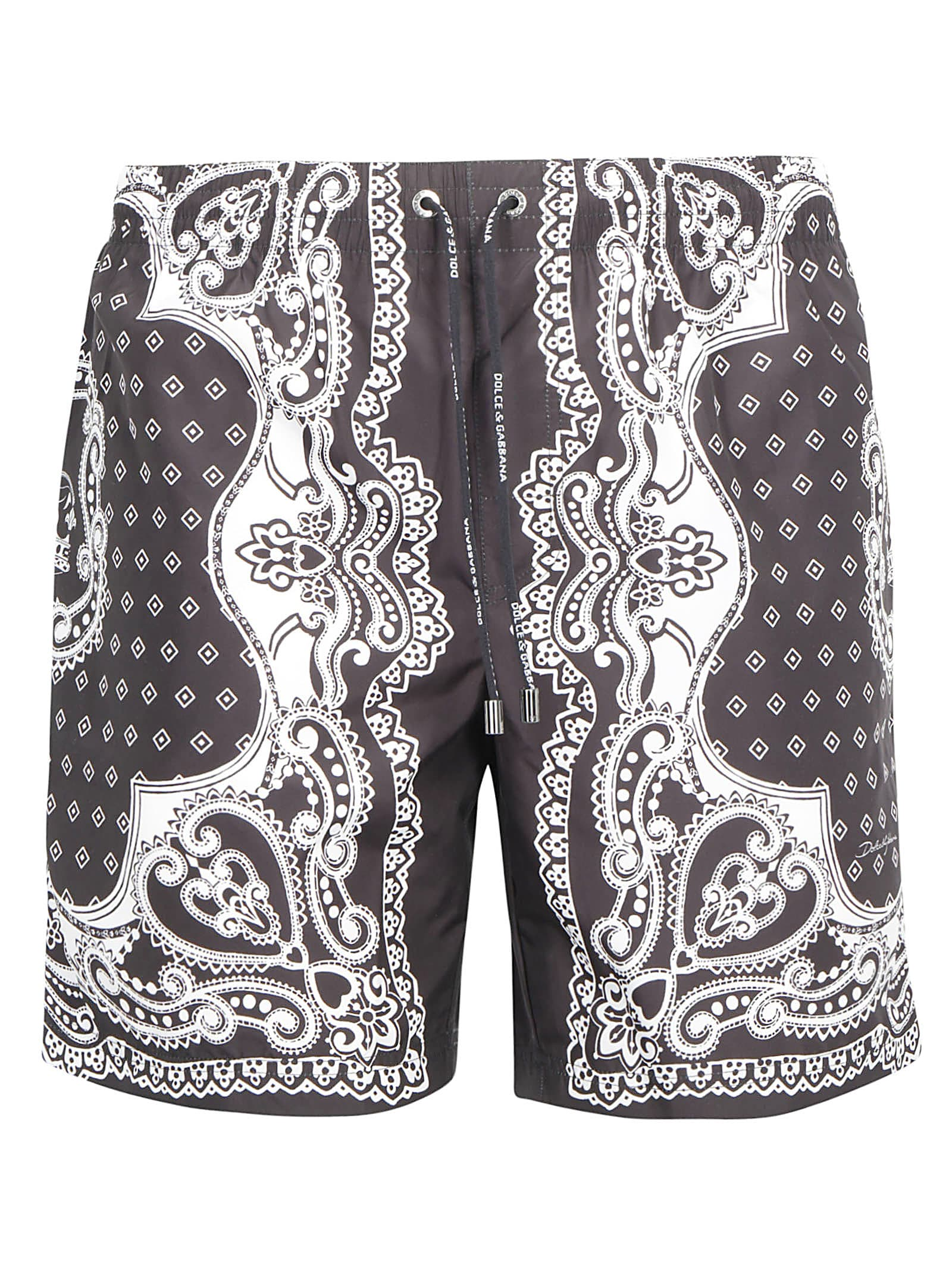 Black Boxer Swimsuit by Dolce & Gabbana, adjustable drawstring waistband, paisley contrast print all over, two welt pockets on front. Composition: 100% Polyester