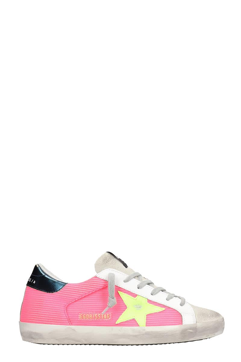 Superstar Sneakers in fuxia synthetic fibers, laces, logo on upper tongue, contrast star, contrast heel notch, rubber outsoleComposition: Synthetic Fibers