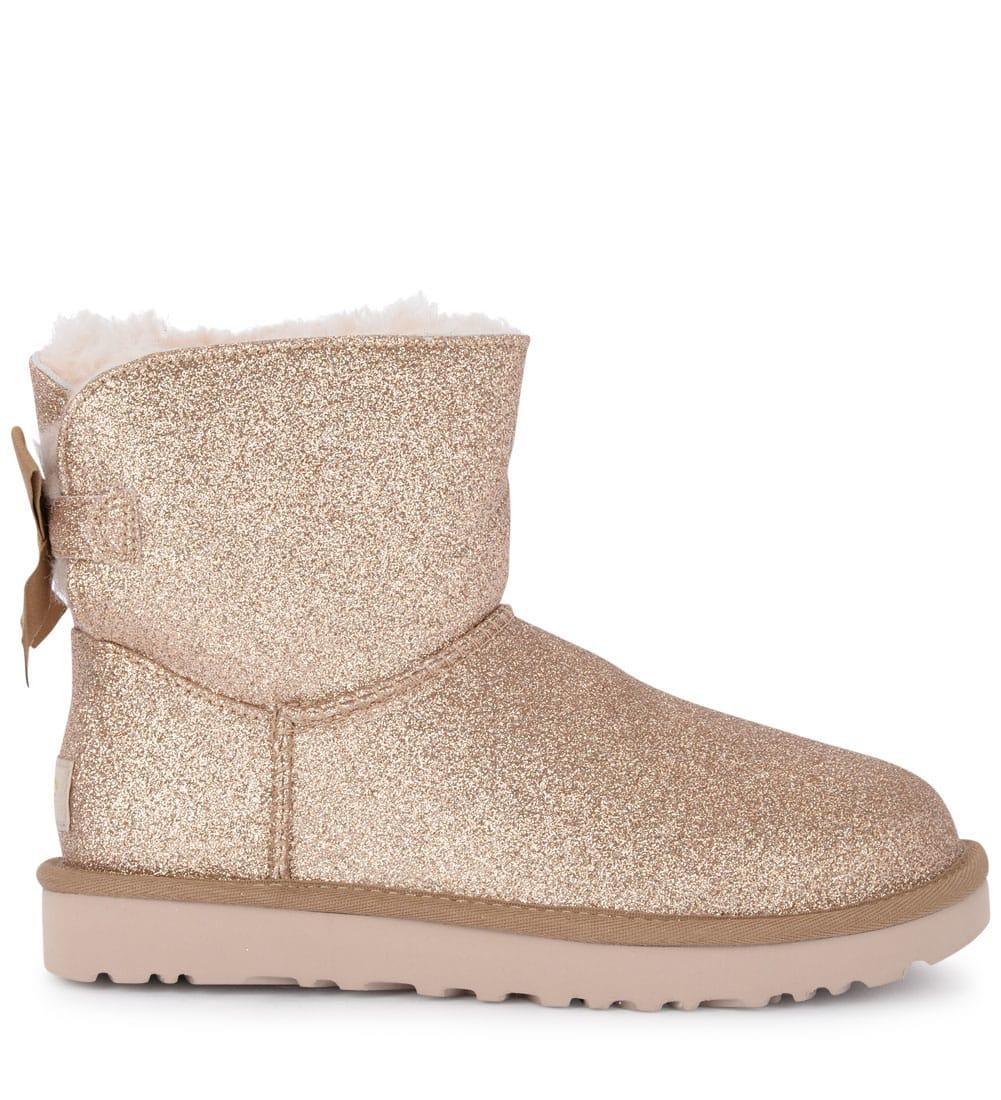 48979faacbd Ugg Mini Bailey Bow Sheepskin And Golden Glitter Ankle Boots