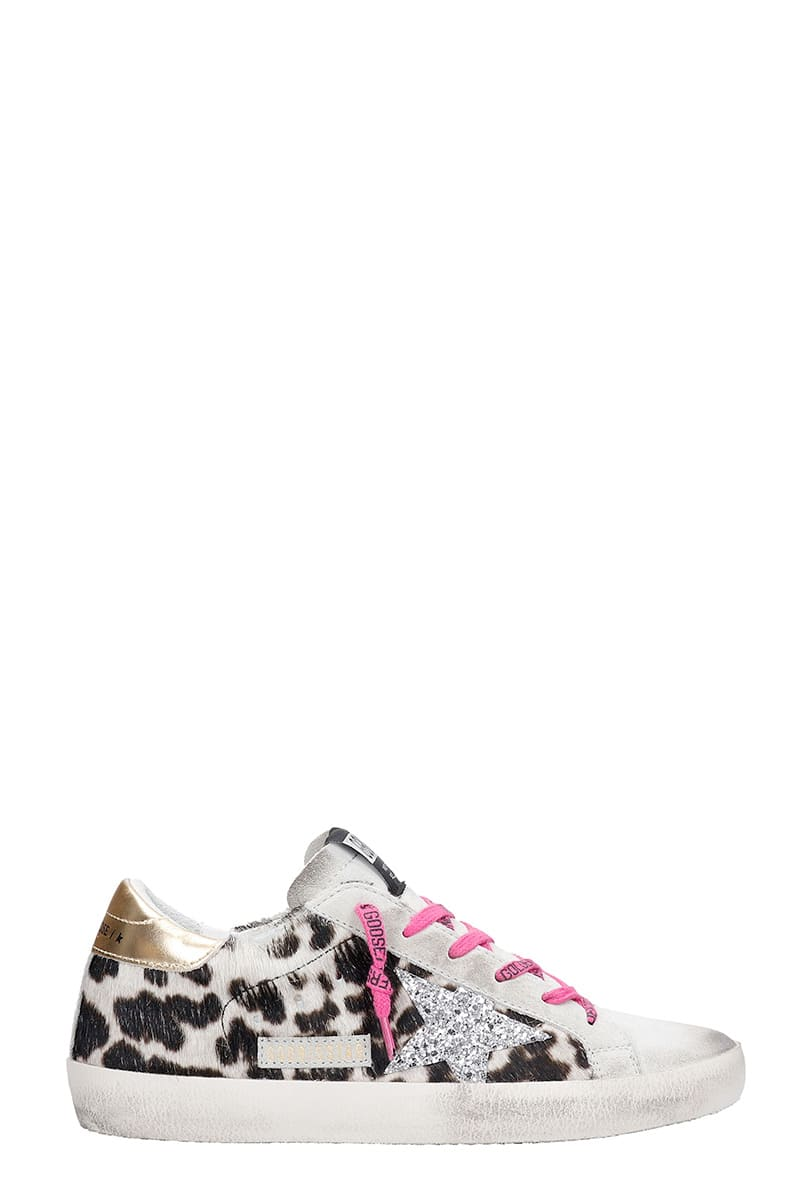 Superstar Sneakers in Animalier pony skin, contrast laces, animalier print, star on side, silver glitter detail, rubber outsoleComposition: Pony Skin