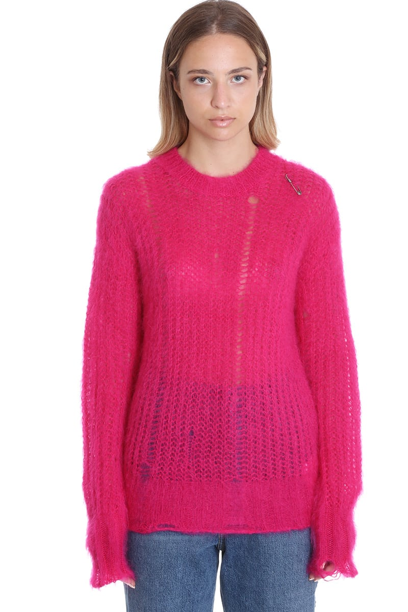 Knitwear in fuxia wool, round neck, long sleeves, destroyed effect, brooch detail, 68% mohair wool 28% polyamide 5% wool, Model is 180 cm and wear a size SComposition: Wool