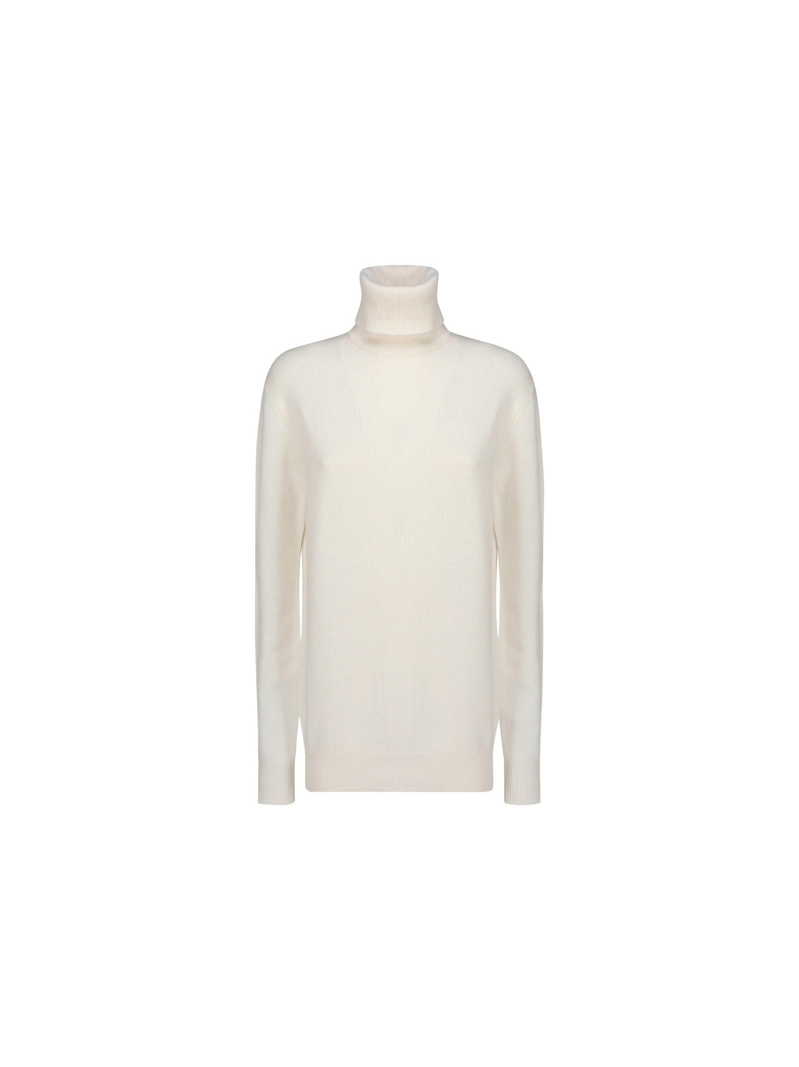 White Cashmere Turtleneck Knitwear by Dolce & Gabbana, high neck, long sleeves, elastic on bottom, brand logo inside label. Composition: 100% Cashmere