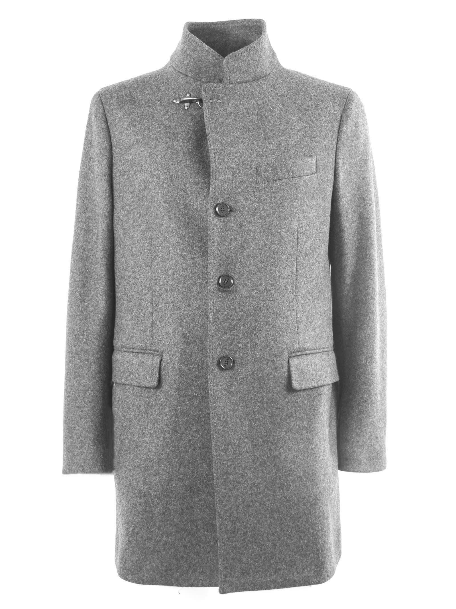 Grey Wool Button-Up Coat Featuring A Buckle Fastening, A Front Button Fastening, Long Sleeves, A Tailored Design, A Broad Welt Chest Pocket, Front Flap Pockets And A Rear Central Vent. Composition: 70% Wool, 25% Polyamide, 5% Other Fibres