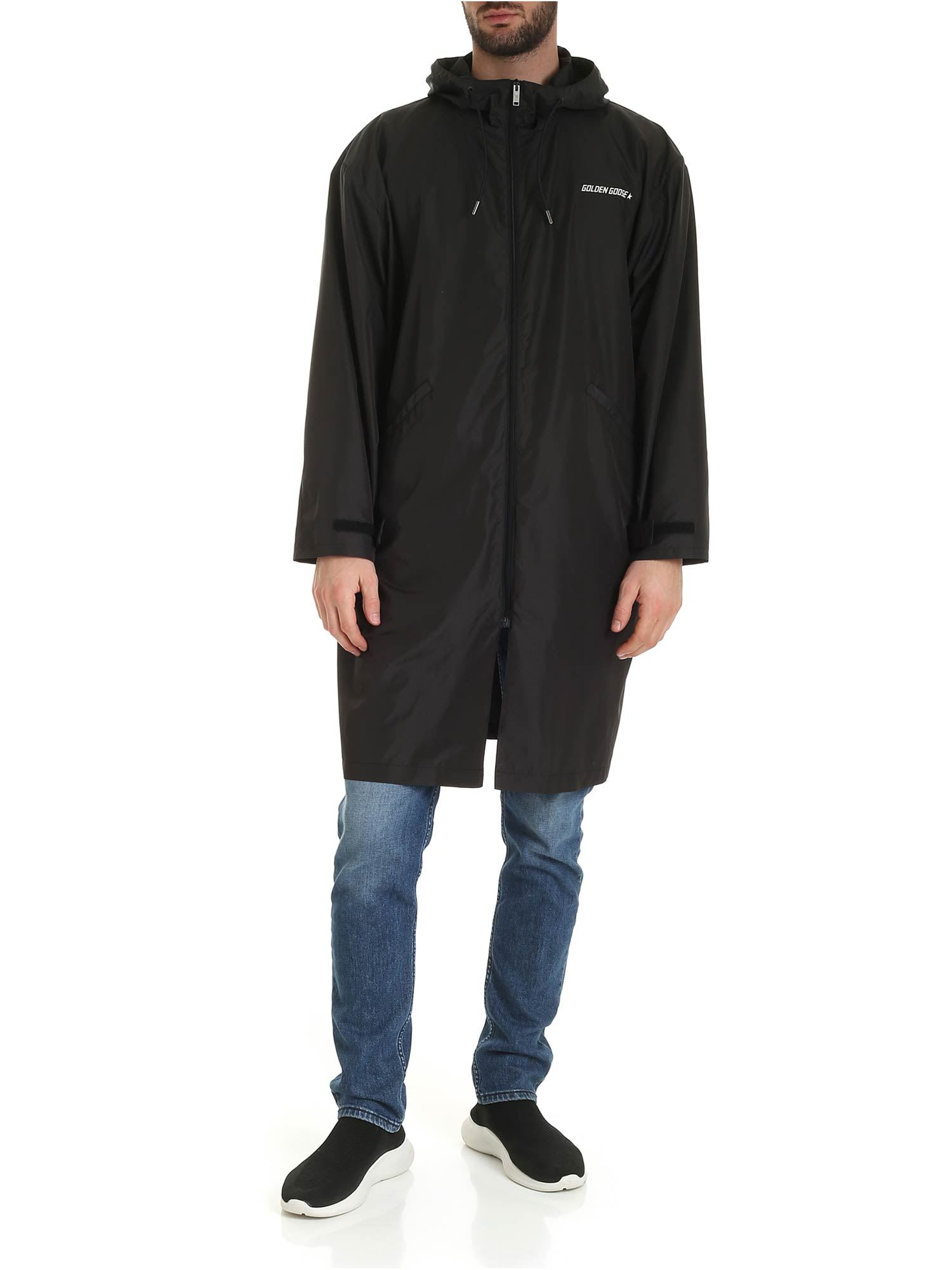 Landon Parka from Golden Goose: Black oversized raincoat with frontal small white logo and white print on back. -fit oversized -composition: 100% nylon -made in italy