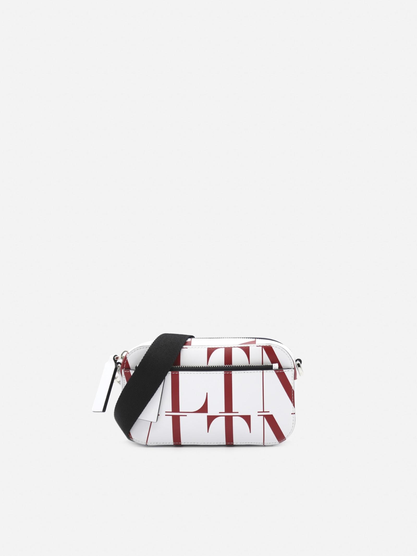 VALENTINO SMALL SHOULDER BAG WITH ALL-OVER VLTN LOGO PRINT