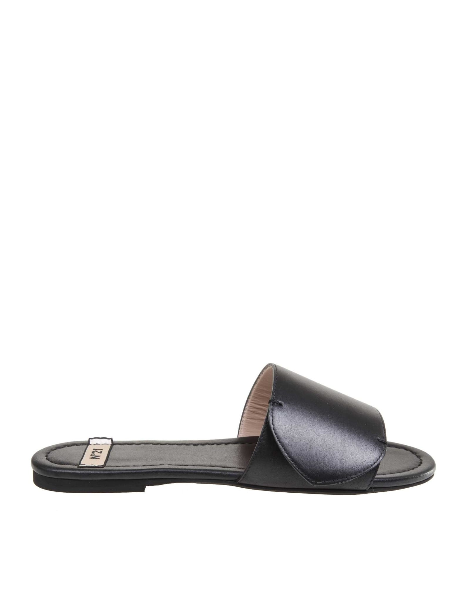 Calfskin sandal black colour model with open round tip golden metal logo leather interior flat heel rubber sole composition: upper: 100% calfskin; lining: 100% goat leather; sole: 100% rubber made in italy