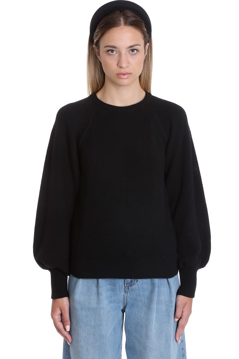 Knitwear in black wool, round neck, puff sleeves, ribbed knit, 45% wool, 10% cachemire, 25% viscosa, 20% poliammide, Model is 180 cm and wear a size SComposition: Wool
