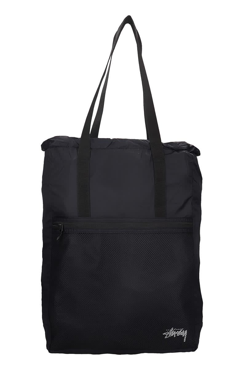 Tote in black nylon, top handle, zip closure, frontal zip pocket, logo print on front, Height 470 mm, Width 370 mmComposition: Nylon