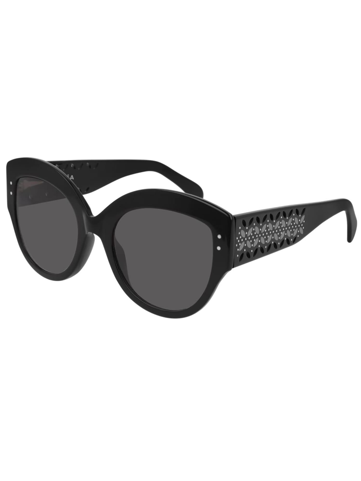Alaïa Round Acetate Sunglasses W/ Perforated Arms In Black