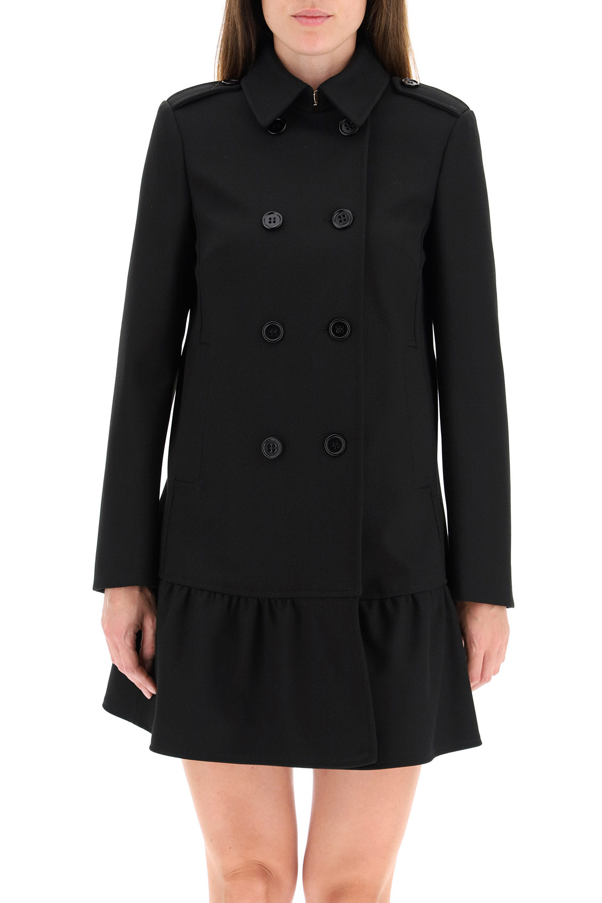Red Valentino double-breasted coat in tricotine tech with flouced hem. It features pointed collar with hook closure, epaulettes, side pockets, decorative martingale with buttons. The model is 177 cm tall and wears a size IT 38. Composition: 72% poliestere, 26% viscosa, 02% elastan
