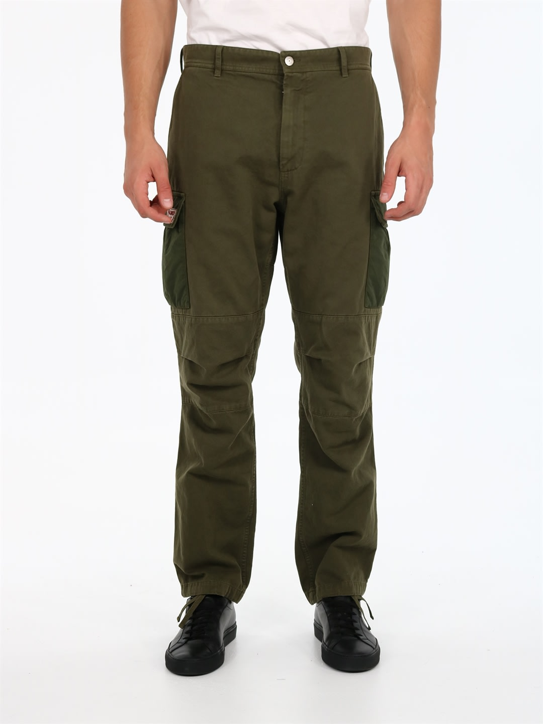 Cargo trousers in military green cotton with side pockets on the legs and adjustable hem with drawstring. Model with side pockets and back flap pockets. Zip and button closure. The model is 1. 90 cm tall and wears size 50IT / LComposition: 100% Cotton