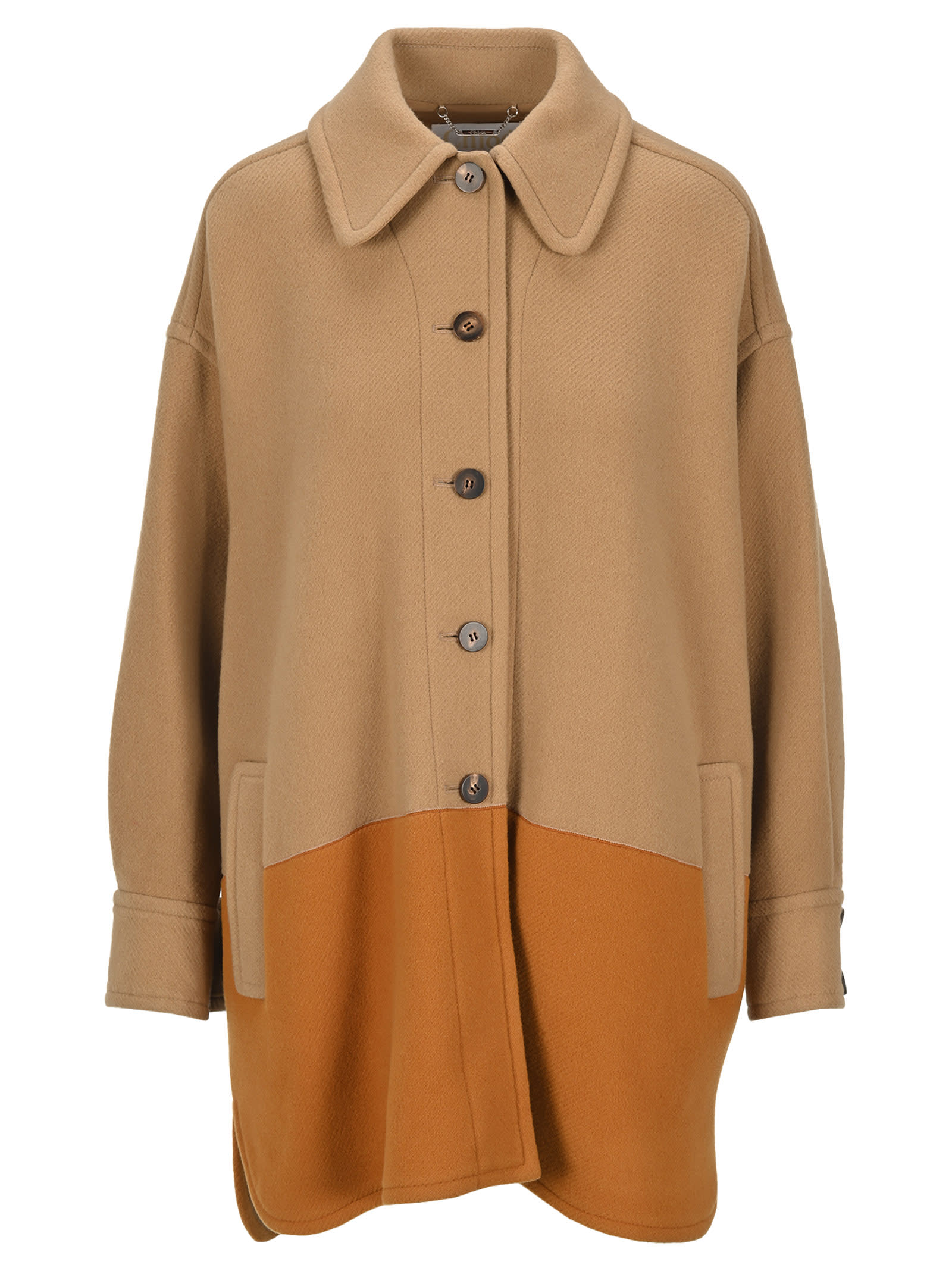 Warn Brown Wool Blend Two Tone Single Breasted Coat By Chloé. Featuring: - Classic Collar; - Front Button Fastening; - Long Sleeves; - Dropped Shoulders; - Front Flap Pockets; - Large Buttoned Cuffs; - Relaxed Fit; - High Low Hem. Composition: 80% WOOL, 20% POLYAMIDE - LINING:, 100% COTTON