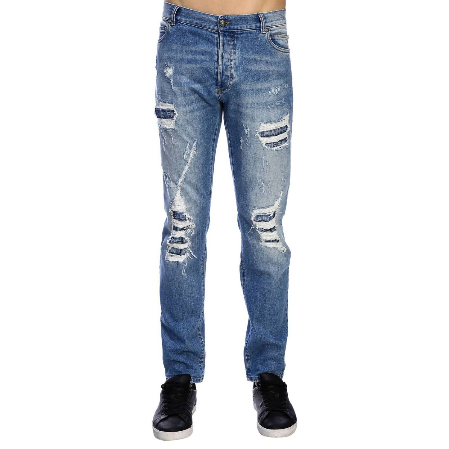 Balmain Jeans Balmain Slim Fit Jeans In Used Effect Denim With Maxi Breaks And Logoed Patches