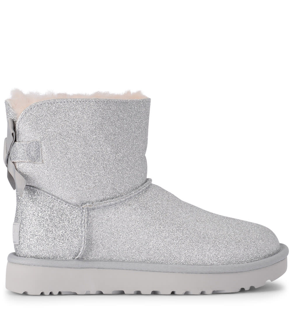 43009123c8 UGG Mini Bailey Bow Glitter And Silver Sheepskin Ankle Boots - ARGENTO ...