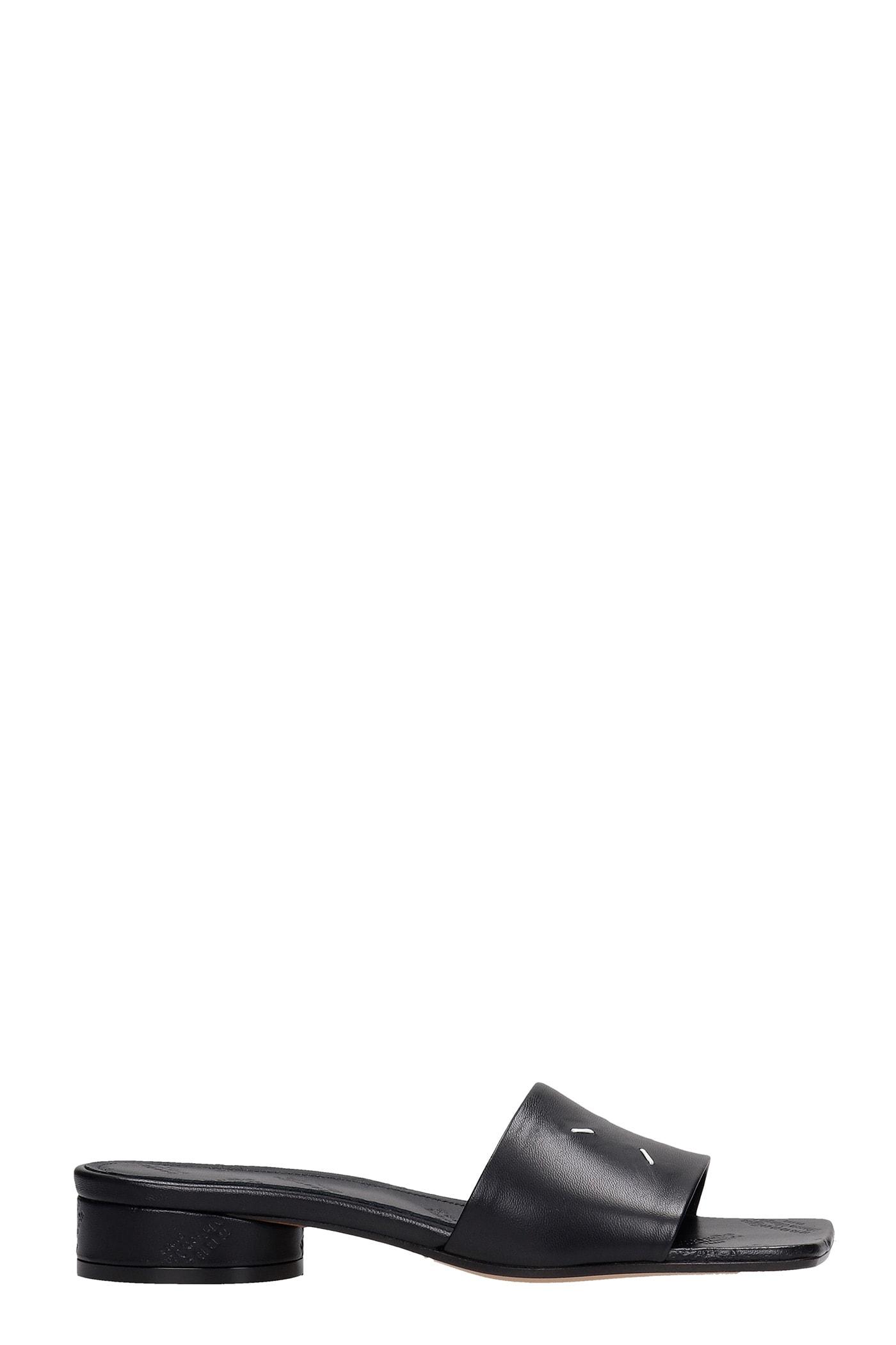 Buy Maison Margiela Flats In Black Leather online, shop Maison Margiela shoes with free shipping