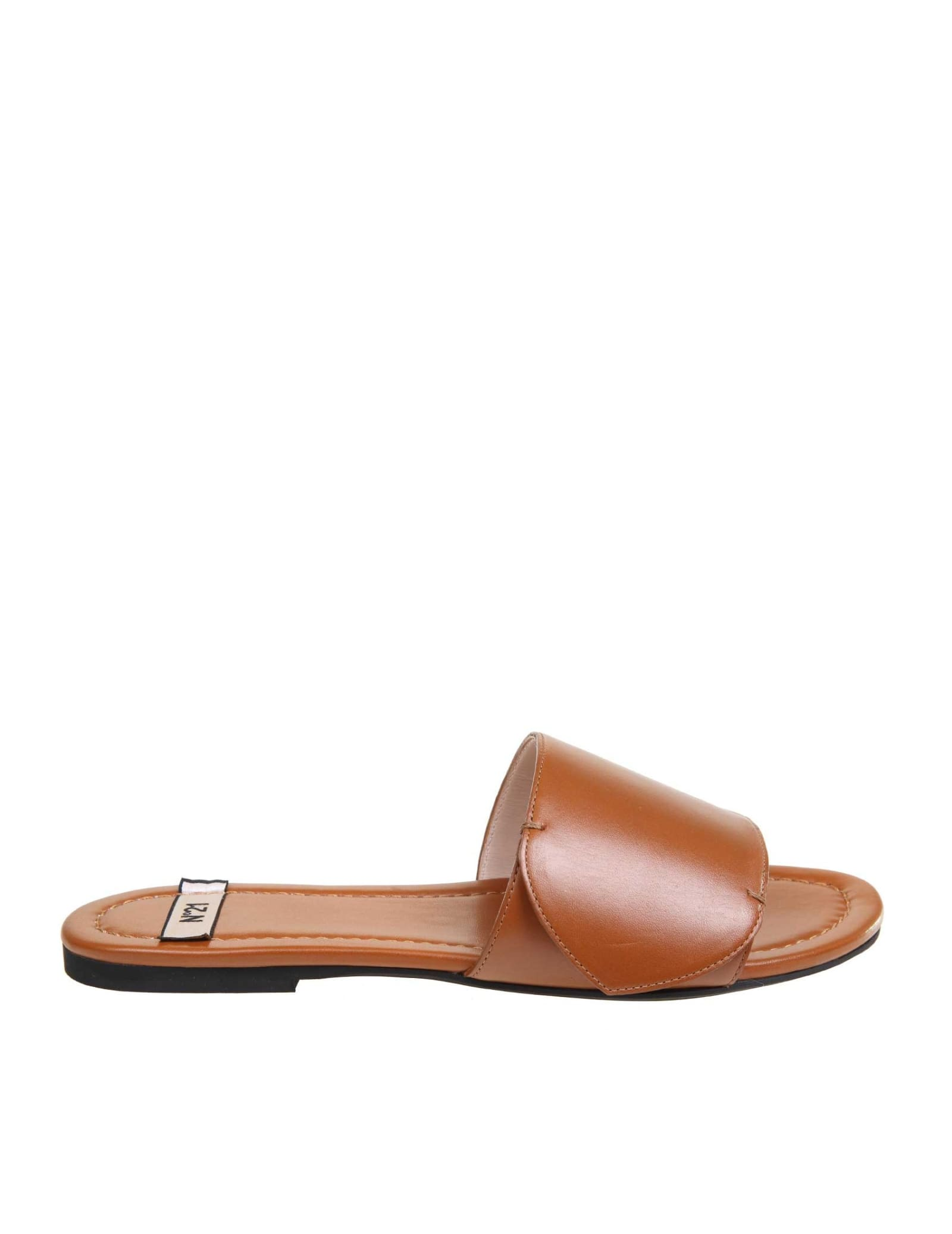Calfskin sandal leather color model with open round tip golden metal logo leather interior flat heel rubber sole composition: upper: 100% calfskin; lining: 100% goat leather; sole: 100% rubber made in italy